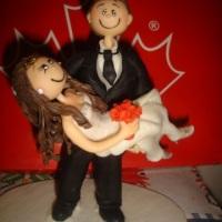 noiva no colo do noivo