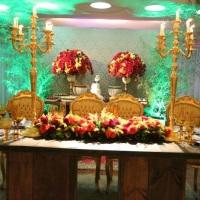 Mesa dos noivos e doces