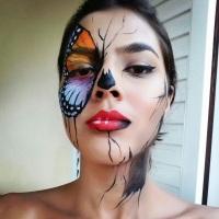 Pintura facial de borboleta estilizada