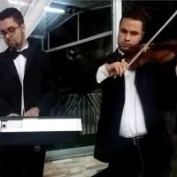 Um Dueto com Teclado e Violino pode ser a opção ideal para sua cerimônia .